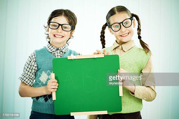 Geek boy and girl holding a blackboard for advertisements.