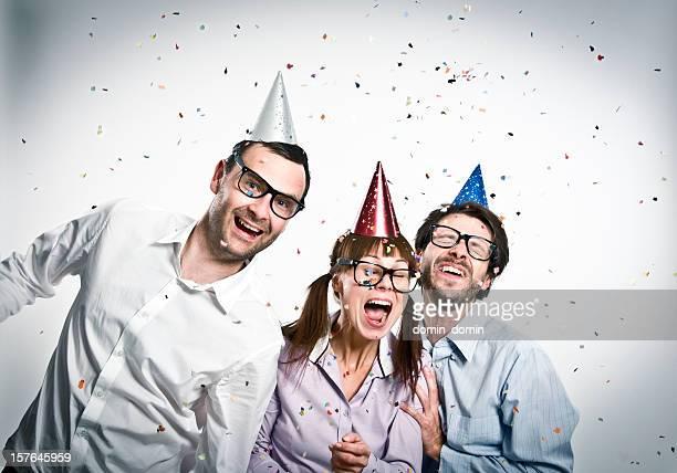 Geek friends at party, happy three nerd people, studio shot