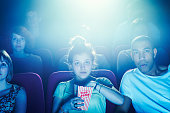Geeky guy and girl on a date at the movies