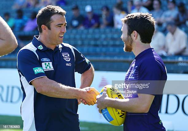 Geelong Cats coach Chris Scott shakes hands with Hayden Ballantyne of the Fremantle Dockers before the round one NAB Cup AFL match between the West...