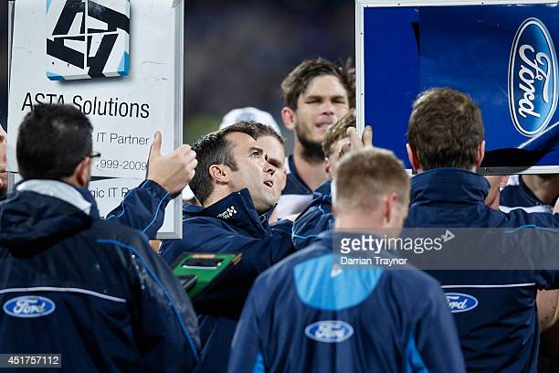 Geelong Cats coach Chris Scott speaks with his players during the round 16 AFL match between the Geelong Cats and the Western Bulldogs at Skilled...