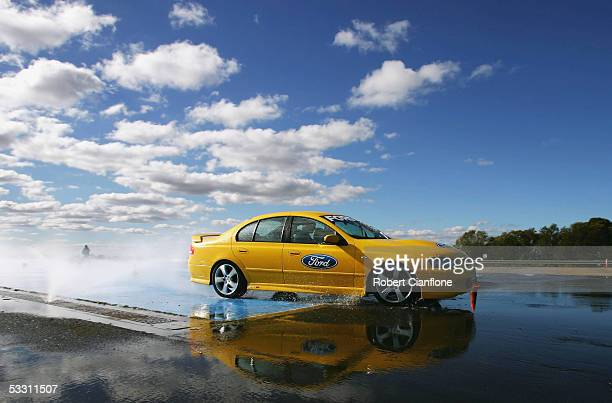 Geelong Cats players test their skills on a skid pan during the Geelong FC Ford Drive Day at the Ford Australia Proving Ground August 1 2005 in...