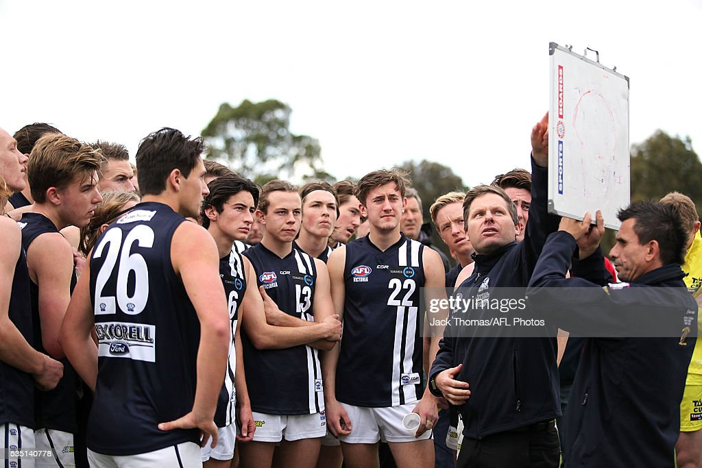 Geelong Falcons Coach Andrew Allthorpe talks to his players during the round eight TAC Cup match between Dandenong Stingrays and Geelong Falcons at Shepley Oval on May 29, 2016 in Melbourne, Australia.