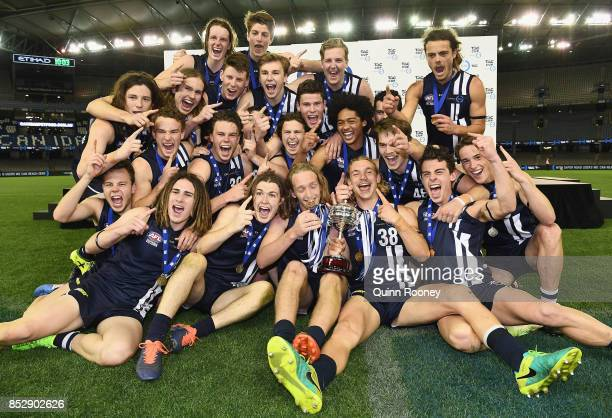 Geelong pose with the trophy after winning the TAC Cup Grand Final match between Geelong and Sandringham at Etihad Stadium on September 24 2017 in...