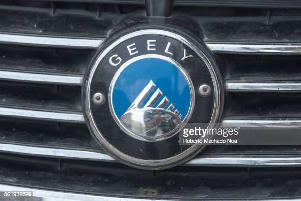 Geely car logo in metal on the front part of a vehicle a blue circle within a black one