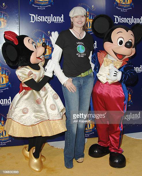 Geena Davis with Minnie Mouse and Mickey Mouse during Disneyland 50th Anniversary 'Happiest Homecoming on Earth' Celebration Arrivals and Fireworks...