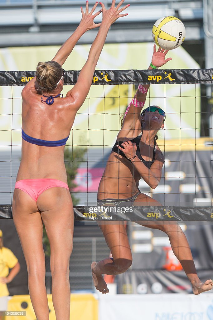 Geena Urango (R) spikes the ball against Megan Wallin-Brockway at the 2014 AVP Cincinnati Open on August 29, 2014 at the Lindner Family Tennis Center in Cincinnati, Ohio.