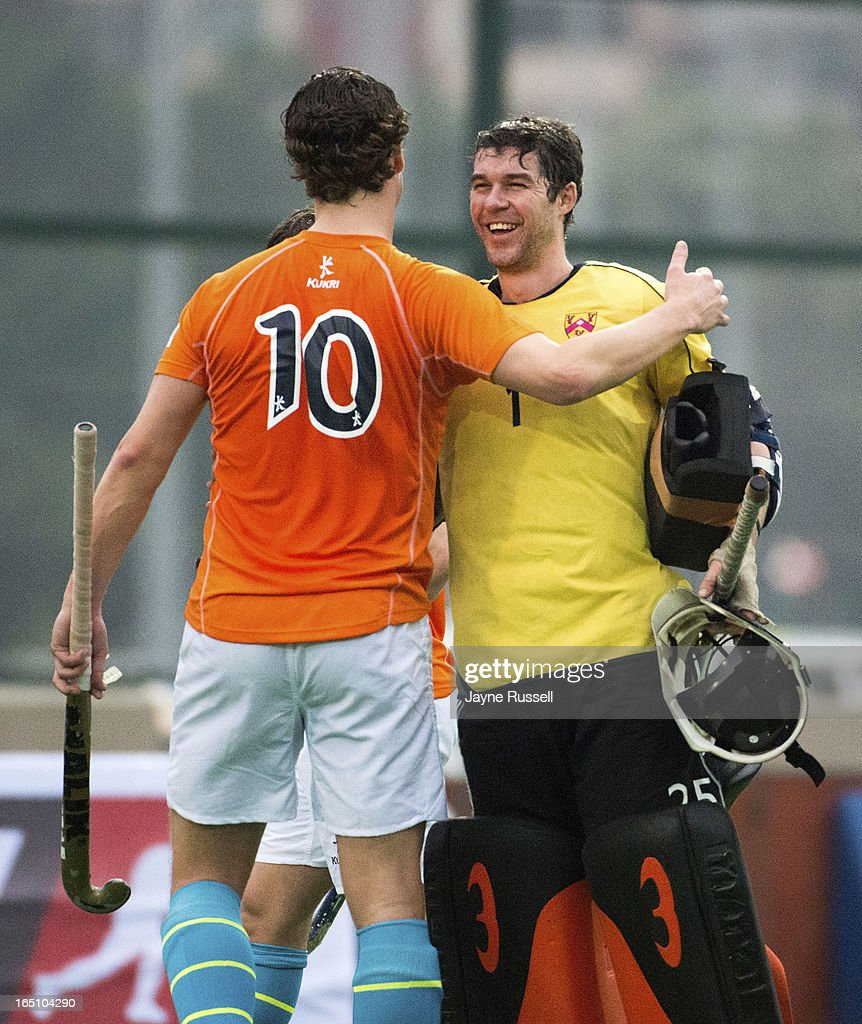 Geert Jan Derikx #10 the Air Team (Holland) (L) congratulates James Fair Goalkeeper for the Water Team (Great Britain) at the end of the match on Day Three of the 2013 Hong Kong 6's at Hong Kong Football Club on March 30, 2013 in Hong Kong, Hong Kong.