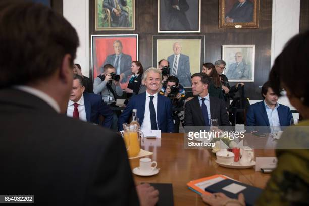 Geert Wilders leader of the Dutch Freedom Party center left and Mark Rutte Dutch prime minister and leader of the Liberal Party speak during a...