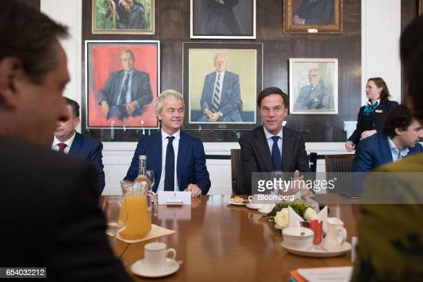 Geert Wilders leader of the Dutch Freedom Party left and Mark Rutte Dutch prime minister and leader of the Liberal Party speak during a meeting at...