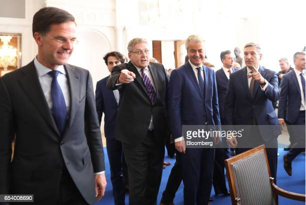 Geert Wilders leader of the Dutch Freedom Party second right stands with Henk Krol leader of the 50Plus party third left and Lodewijk Asscher leader...