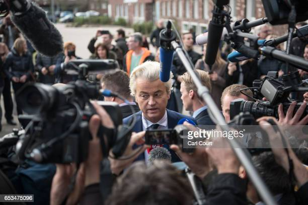 Geert Wilders the leader of the rightwing Party for Freedom speaks to the media after casting his vote during the Dutch general election on March 15...