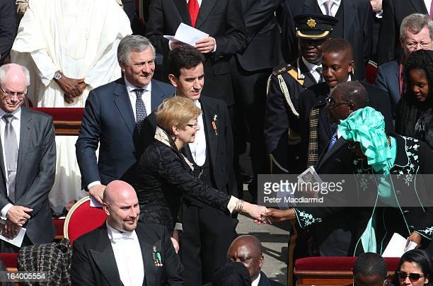Geertrui Windels wife of the President of the European Council Herman van Rompuy shakes hands with Grace Mugabe the wife of Zimbabwe President Robert...