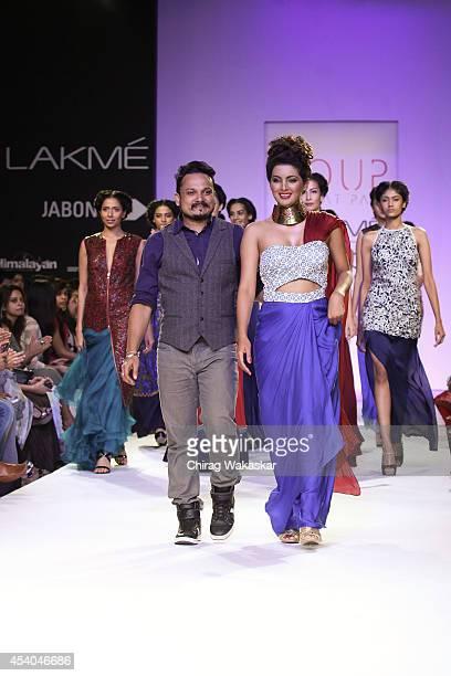 Geeta Basra Sougat Paul walk the runway during day 4 of Lakme Fashion Week Winter/Festive 2014 at The Palladium Hotel on August 23 2014 in Mumbai...