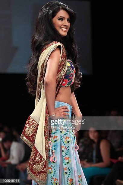 Geeta Basra walks the runway at the Parvesh Jai show at Lakme Fashion Week Summer/ Resort 2011 at the Grand Hyatt on March 11 2011 in Mumbai India