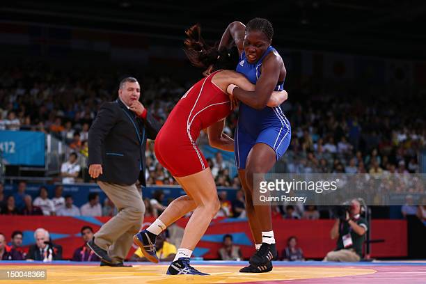 Geeta Geeta of India and Tetyana Lazareva of Ukraine compete in the Women's Freestyle 55 kg Wrestling on Day 13 of the London 2012 Olympic Games at...