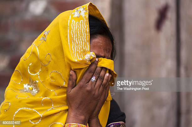 Geeta who says she was a victim of rape weeps in front of her house in Gula Village Bareilly India on February 10 2016 Geeta claims she was raped by...