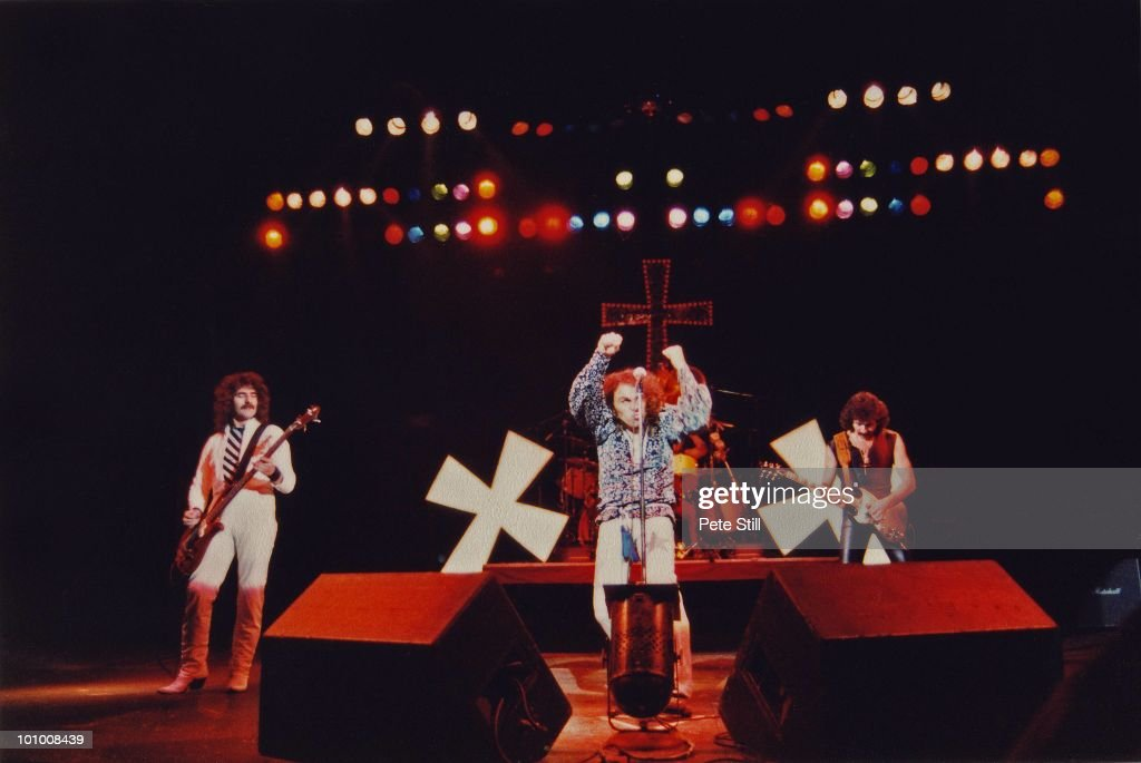 Geezer Butler, Ronnie James Dio, Vinny Appice (hidden, on drums) and Tony Iommi of Black Sabbath perform on stage during their 'Heaven and Hell' tour at Hammersmith Odeon, on January 18th, 1981 in London, England.
