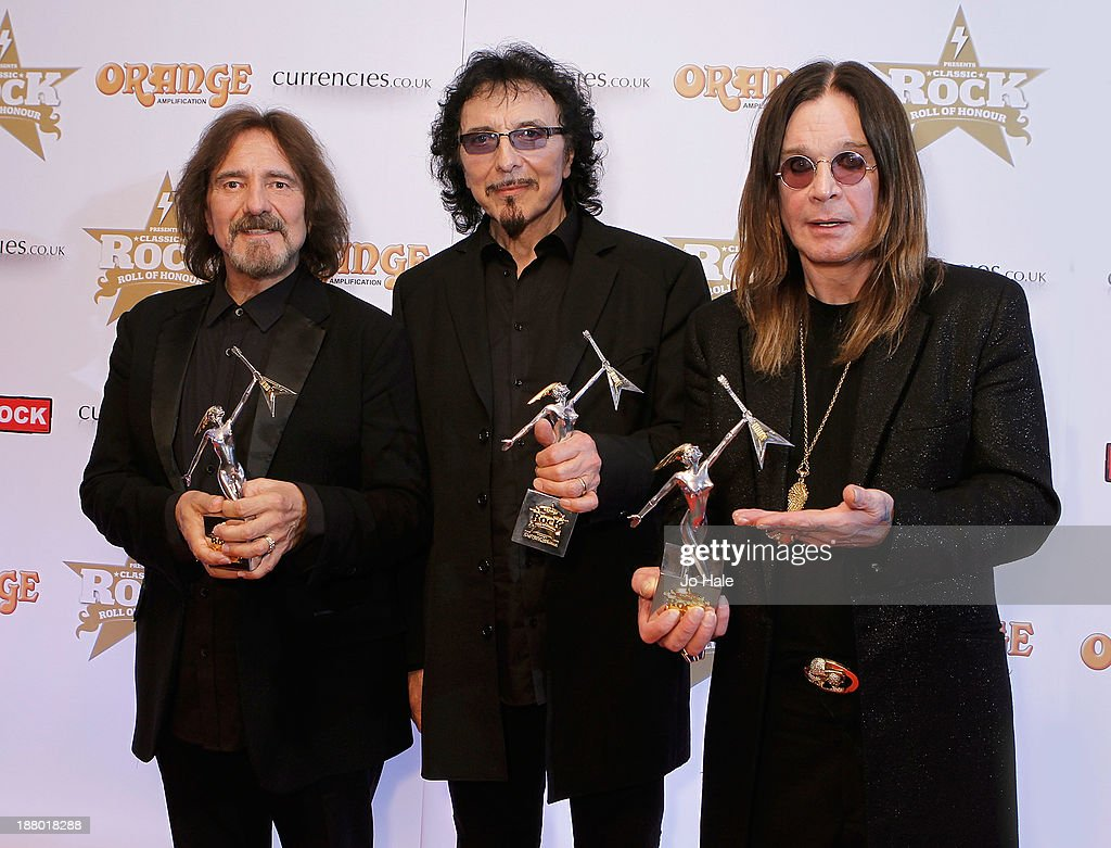 Geezer Butler, Tony Iommi and Ozzy Osbourne of Black Sabbath win the Event of the Year,Album of the Year 2013 and Living Legends Awards the Classic Rock Roll of Honour at The Roundhouse on November 14, 2013 in London, England.