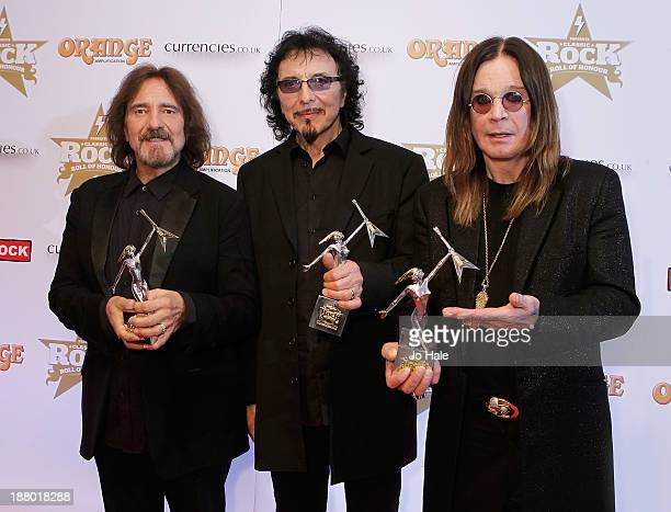 Geezer Butler Tony Iommi and Ozzy Osbourne of Black Sabbath win the Event of the YearAlbum of the Year 2013 and Living Legends Awards the Classic...