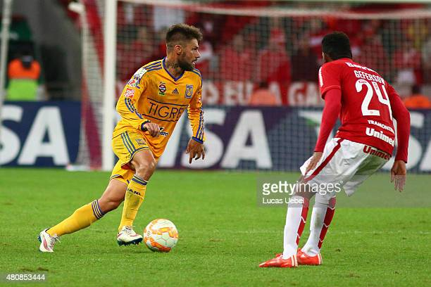 Geferson of Internacional battles for the ball against Rafael Sobis of Tigres during the match between Internacional v Tigres as part of Copa...