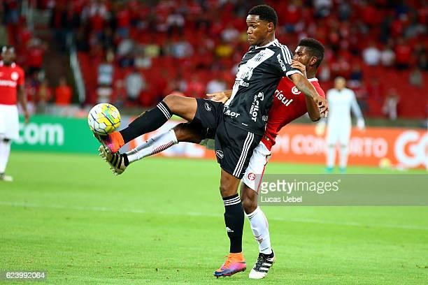 Gefferson of Internacional battles for the ball against Rhayner of Ponte Preta during the match between Internacional and Ponte Preta as part of...