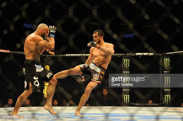 Gegard Mousasi grapples with Costas Philippou in their featherweight bout during the UFC Fight Night event at the Mall Of Asia Arena on May 16 2015...