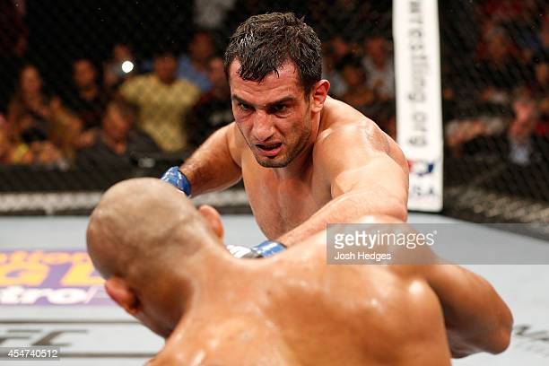 Gegard Mousasi looks to strike Ronaldo 'Jacare' Mousasi in their middleweight bout during the UFC Fight Night event at Foxwoods Resort Casino on...