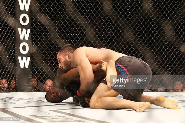 Gegard Mousasi of Iran attempts to lock a submission against Uriah Hall of Jamaica in their middleweight bought during UFC Fight Night at Saitama...
