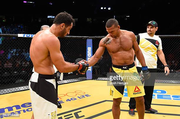 Gegard Mousasi of The Netherlands and Thiago Santos of Brazil shake hands after their middleweight bout during the UFC 200 event on July 9 2016 at...