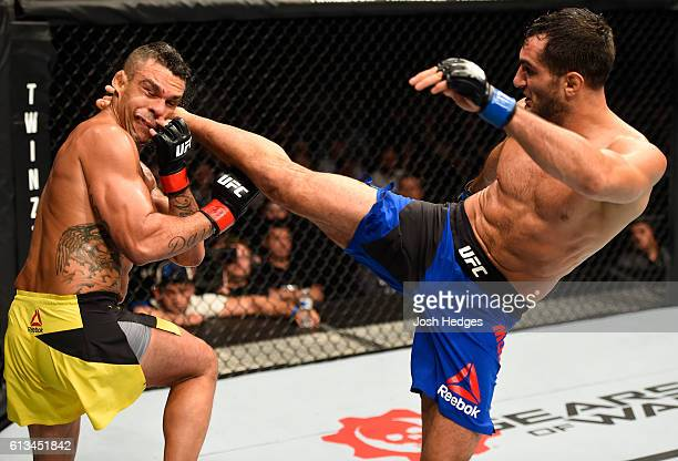Gegard Mousasi of The Netherlands kicks Vitor Belfort of Brazil in their middleweight bout during the UFC 204 Fight Night at the Manchester Evening...