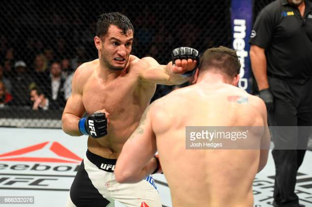 Gegard Mousasi of the Netherlands lands a punch on Chris Weidman in their middleweight bout during the UFC 210 event at KeyBank Center on April 8...