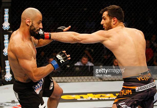 Gegard Mousasi of the Netherlands punches Costas Philippou of the United States in their middleweight fight during the UFC Fight Night event at the...