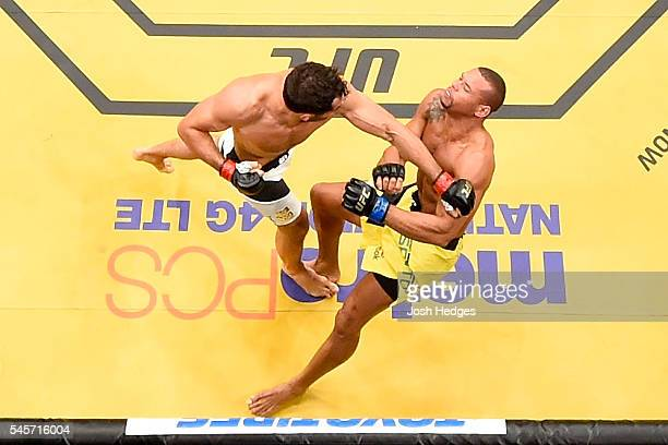 Gegard Mousasi of The Netherlands punches Thiago Santos of Brazil in their middleweight bout during the UFC 200 event on July 9 2016 at TMobile Arena...