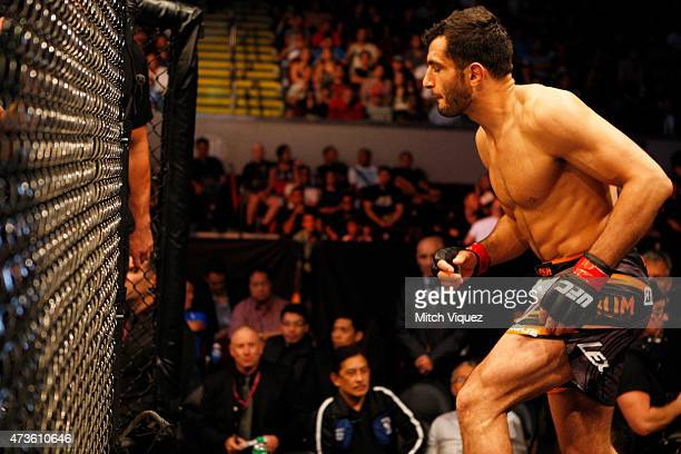 Gegard Mousasi of the Netherlands runs in the cage before his middleweight fight during the UFC Fight Night event at the Mall of Asia Arena on May 16...