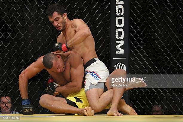 Gegard Mousasi punches Thiago Santos during the UFC 200 event at TMobile Arena on July 9 2016 in Las Vegas Nevada