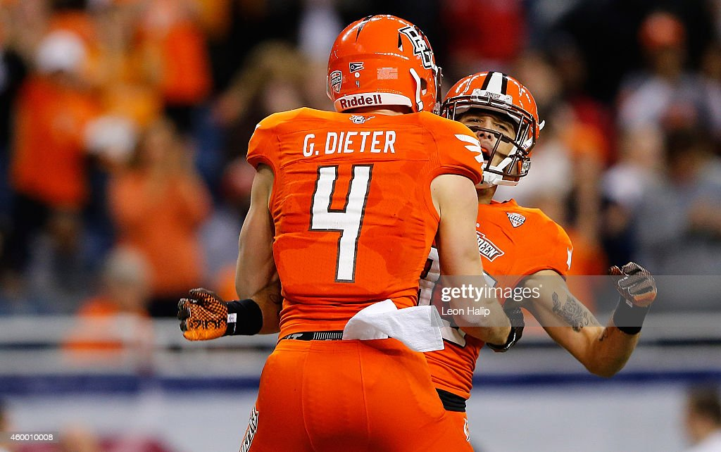 Gehrig Dieter of the Bowling Green Falcons celebrates with Heath Jackson after catching a 42 yard touchdown pass during the second quarter of the MAC...