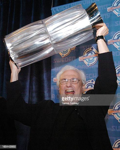 Gehry_NHLMay 12 2004Architect Frank Gehry hoists the newly designed World Cup of Hockey trophy above his head like a Stanley Cup win at the trophy's...