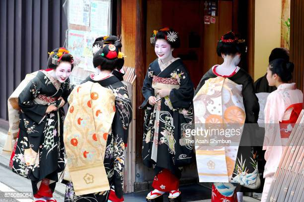 Geiko and Maiko greet to their masters on August 1 2017 in Kyoto Japan Hassaku August first in old Japanese lunar calendar when geiko and maiko visit...