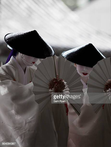 CONTENT] Geiko performing during an annual public event as part of the Gion festival