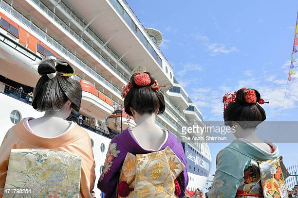 Geiko welcome passengers as the cruiser Celebrity Millennium arrives at Shimizu Port on April 30 2015 in Shizuoka Japan The cruiser calls at Shizuoka...