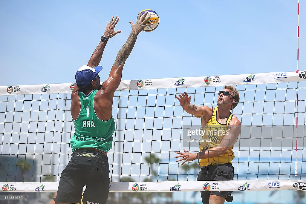 Geir Eithun (R) of Norway spikes the ball over Pedro Salgado of Brazil during the round of pool play at the ASICS World Series of Beach Volleyball - Day 3 on July 24, 2013 in Long Beach, California.