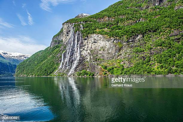 Geirangerfjord, Seven Sisters waterfall, Dei Sju Systrene in Norwegian, Knivsfla farm top right, More og Romsdal province, Vestland or Western Norway, Norway