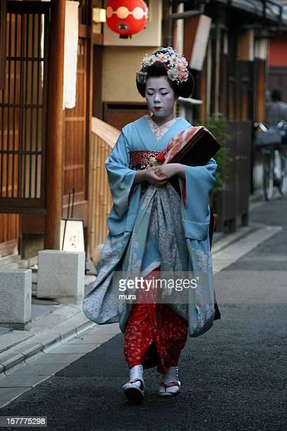 Geisha apprentice walking in Gion
