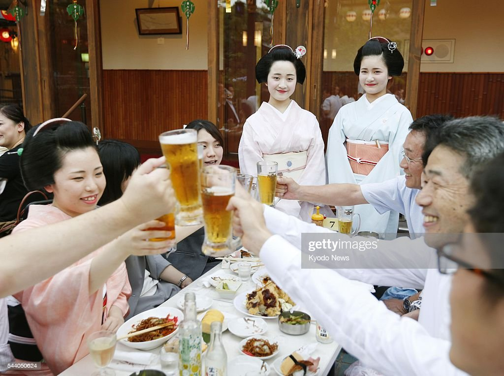 Geisha entertain customers at a beer garden in the ancient Japanese capital of Kyoto on July 1, 2016, when the seasonal feature of summer started. People can enjoy beer with geisha through Sept. 5.