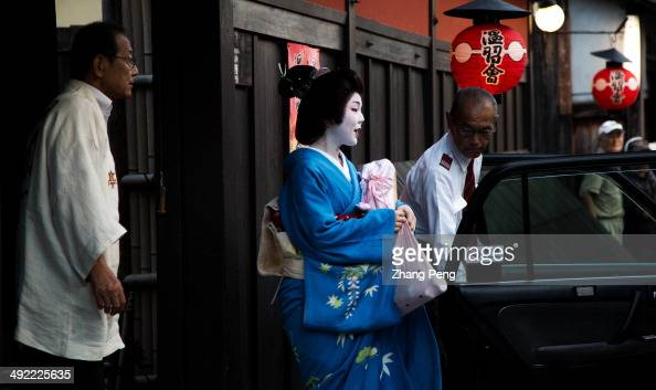 Geisha girl is getting in to a taxi to go to work They perform in ...