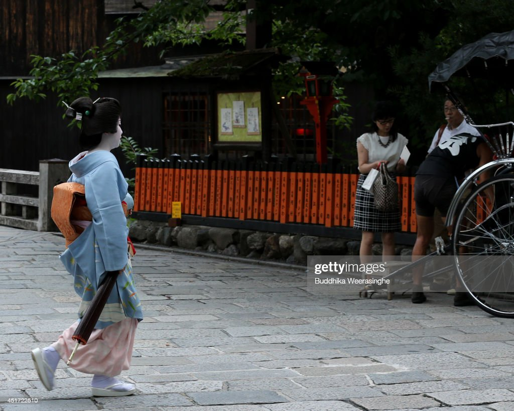 A Geisha girl walks at Gion Street on July 5, 2014 in Kyoto, Japan. Kyoto has been named the world's best city in the U.S. magazine Travel + Leisure for 2014, according to its website. The former capital of Japan is known for old temples and shrines.