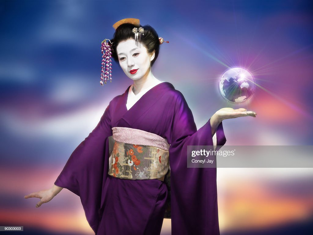 Geisha holding a small metallic floating globe