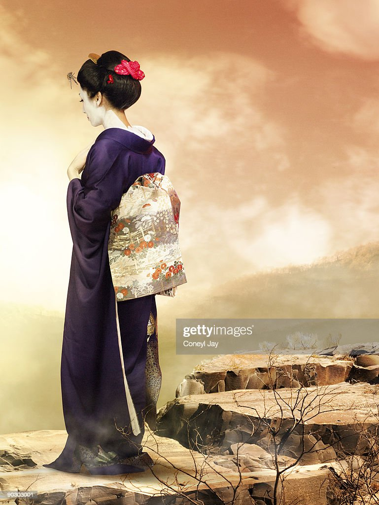 Geisha looking at the sunset from a cliff