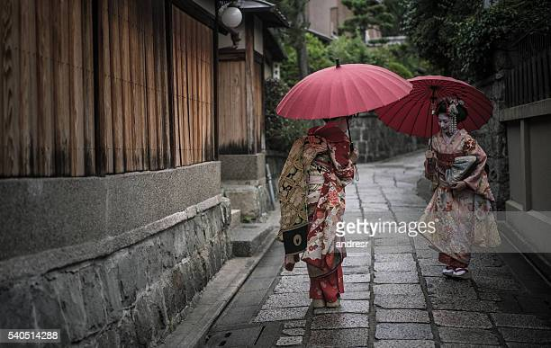 Geishas greeting each other outdoors
